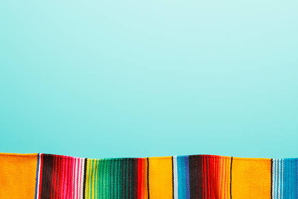 Traditional Mexican Blanket A traditional Mexican blanket on a blue background with copy space at the top mexican culture stock pictures, royalty-free photos & images