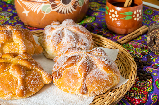 Traditional Mexican bread of the dead (pan de muerto) with coffe