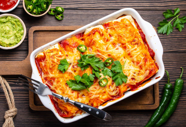 traditional mexican enchiladas - casserole stock photos and pictures