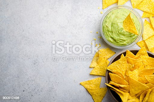 istock Traditional mexican homemade guacamole sauce in a glass bowl and 900912498
