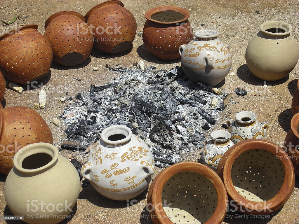 Traditional Mexican pottery being bonfire-fired stock photo