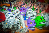Traditional Mexican skull masks for sale in the market. Travel background for Mexico, Latin America.