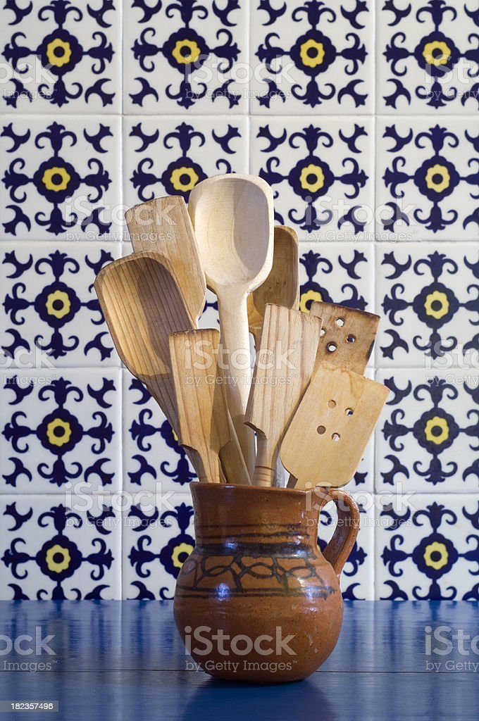 Traditional Mexican wooden spoons and tiles stock photo