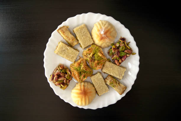 Traditional middle eastern mamoul cookies and assorted baklawa. Top view stock photo