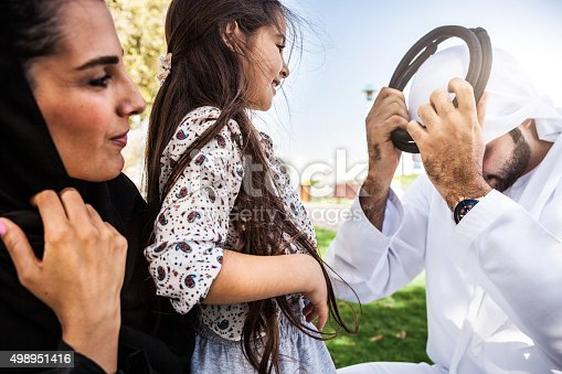 472869308 istock photo Traditional middle eastern young family enjoying weekend 498951416