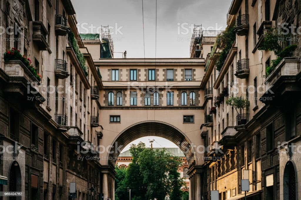 Traditional Milanese buildings with an impressive arch on Via Tommaso Salvini in Milan's Porta Venezia district, Lombardy, Italy royalty-free stock photo