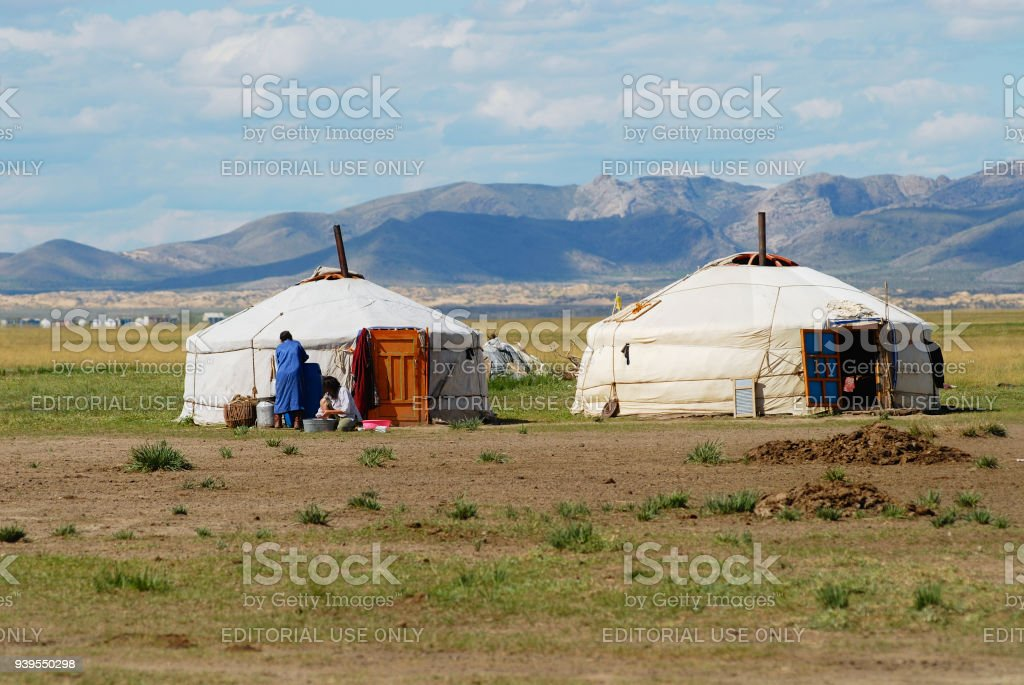 Traditional Mongolian yurts (nomadic tents) located in steppe circa Kharkhorin, Mongolia. stock photo