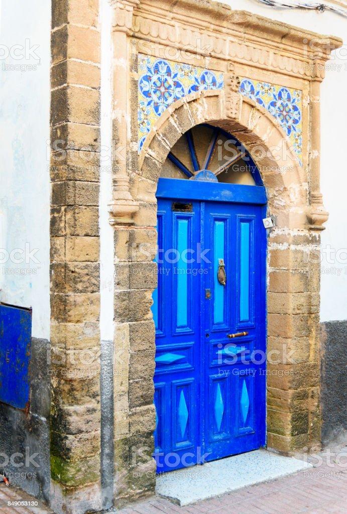 Traditional Moroccan blue door in medina. Essaouria, Morocco stock photo