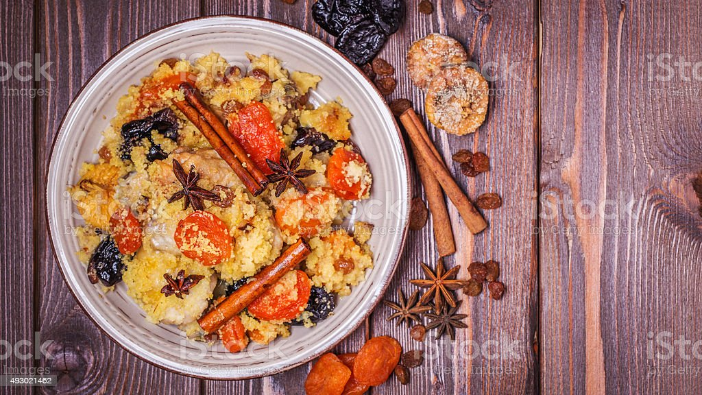 Traditional moroccan chicken with dried fruits and spices. stock photo