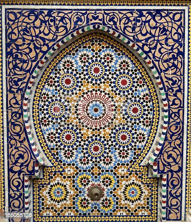 Traditional Moroccan fountain with mosaic tiles found outside a mosque in the souk of Rabat