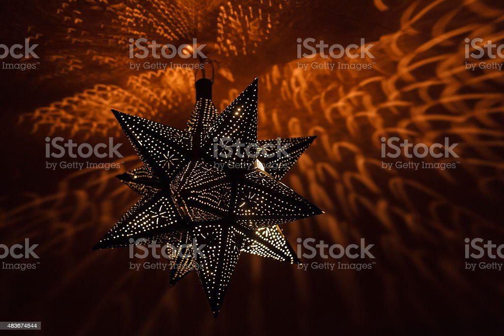 Traditional moroccan lamp illuminating the ceiling royalty-free stock photo