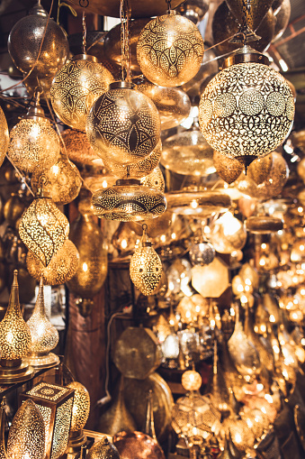 994119256 istock photo Traditional moroccan souvenir lamps on local market souk in Marrakesh medina. Handmade work, different shapes. 1264934262