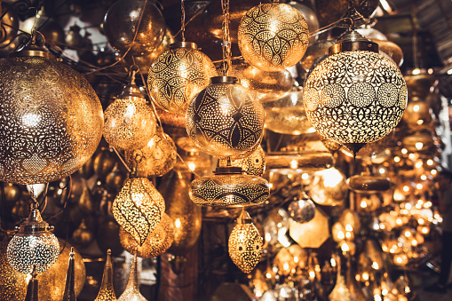 994119256 istock photo Traditional moroccan souvenir lamps on local market souk in Marrakesh medina. Handmade work, different shapes. 1271113755