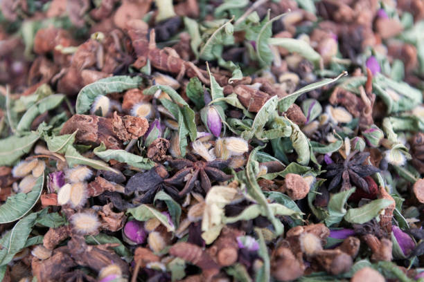 Traditional moroccan tea mixture with dried herbs, spices and rose buds. stock photo