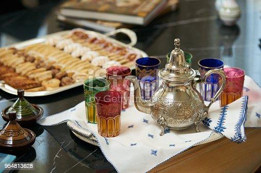 1189561410 istock photo Traditional Moroccan tea with Ramadan cookies 954813628