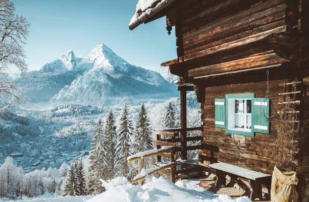 Traditional mountain cabin in the Alps in winter Beautiful view of traditional wooden mountain cabin in scenic winter wonderland mountain scenery in the Alps chalet stock pictures, royalty-free photos & images