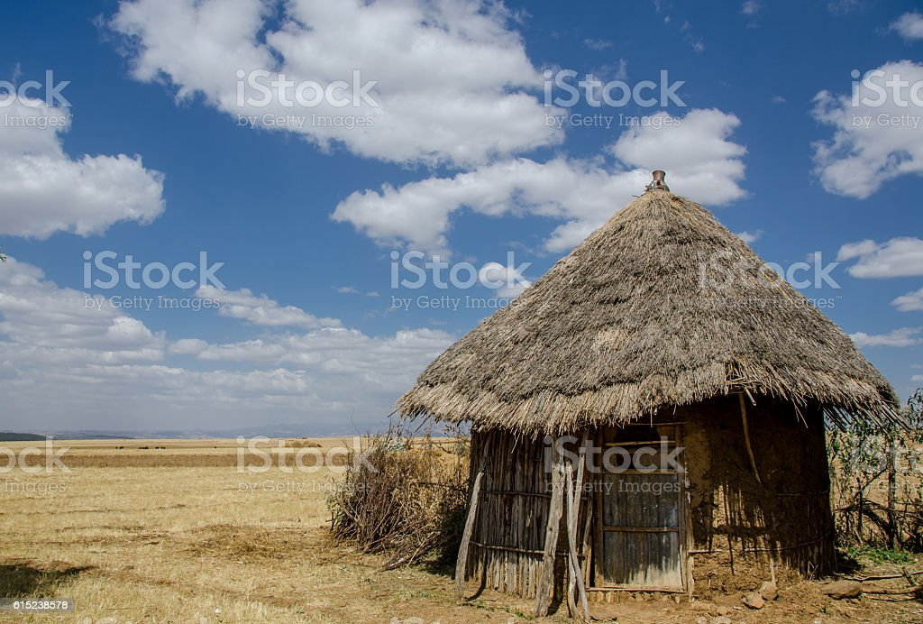 traditional mud and stick Ethiopian hut with a thatch roof stock photo