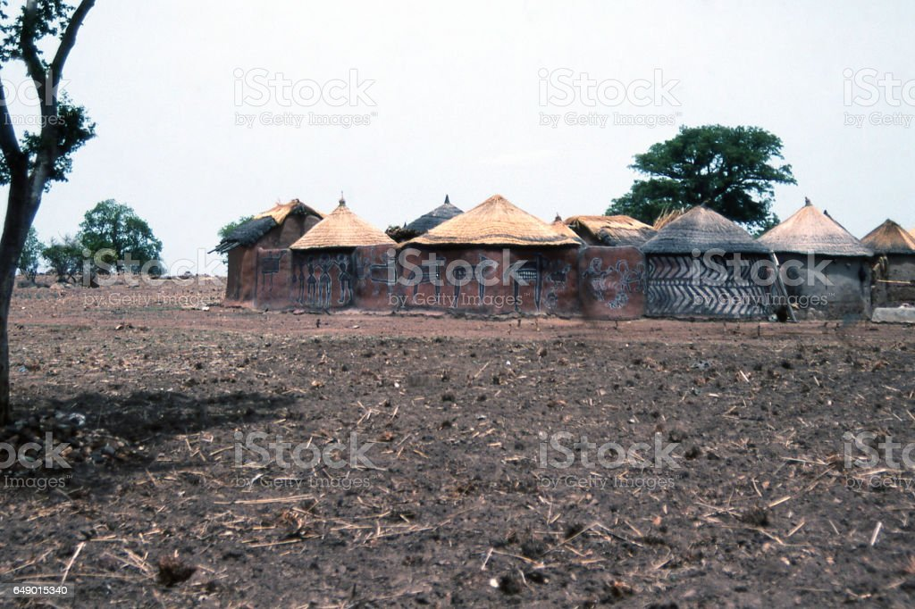 Traditional mud huts with indigenous art on walls of residential farm compound near Bolgatanga Ghana Africa stock photo