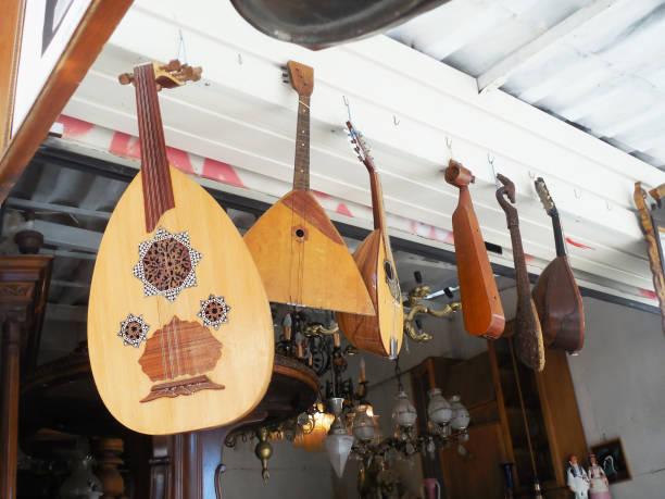 traditional musical instruments at an antique shop Monastiraki Athens Greece - oud, balalaika, bouzouki, mandolin, greek baglamas, pontic lyra stock photo