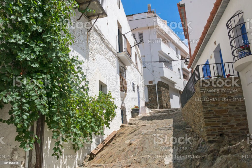 Traditional narrow street with white houses in historical center of city stock photo