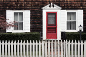 Traditional New England home with white picket fence