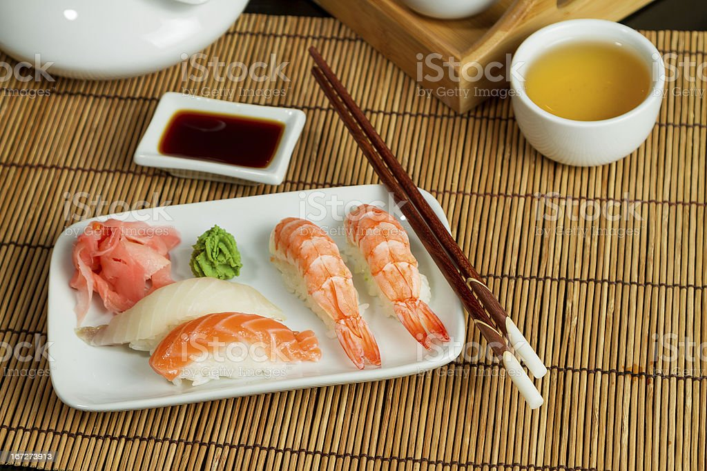 Traditional Nigiri Sushi on the white plate royalty-free stock photo