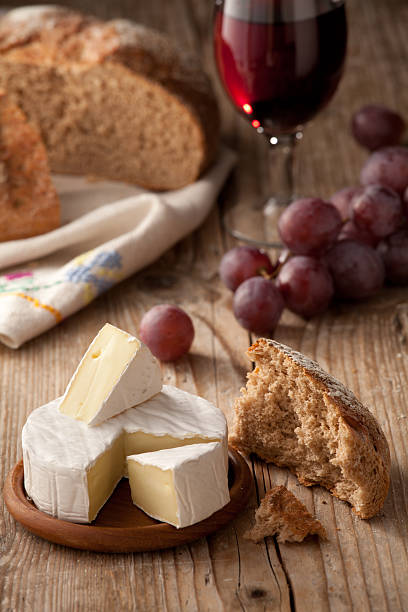 Traditional Normandy Camembert cheese with homemade bread, vine stock photo
