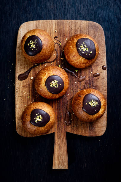 traditional old fashioned fastelavnboller or danish cream cakes - fastelavn stock pictures, royalty-free photos & images