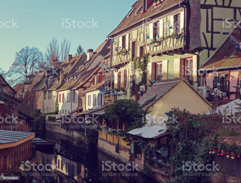 Traditional  old  houses on the canal decorated for Christmas, Colmar, Alsace, France. Toned image. stock photo