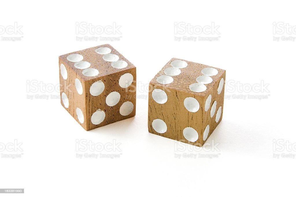 Traditional old wooden dice isolated on a white background royalty-free stock photo