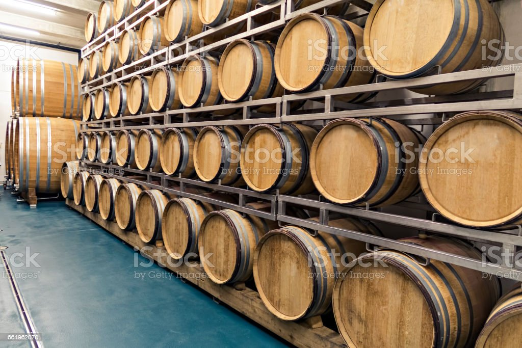 Traditional old woodenbarrels are used in top wine cellars for storing wine, whiskey,rum or cider. stock photo