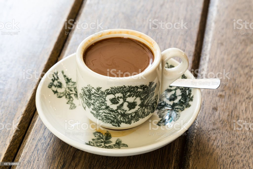 Traditional oriental Chinese coffee in vintage mug and saucer stock photo