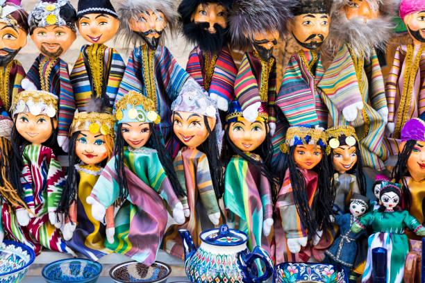 Traditional oriental doll in Bukhara Bazaar, Uzbekistan Traditional oriental doll in Bukhara Bazaar, Uzbekistan muziekfestival stock pictures, royalty-free photos & images
