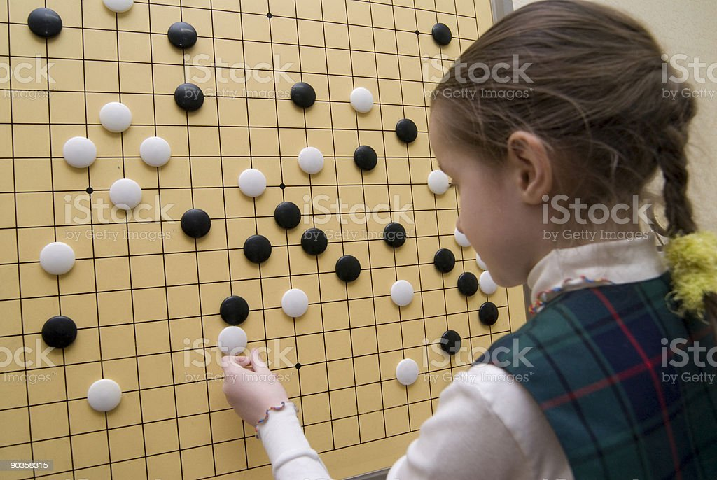 Traditional oriental logic game GO royalty-free stock photo