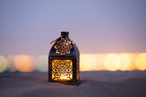 traditional ornamental arabic lantern in desert. - eid stock pictures, royalty-free photos & images