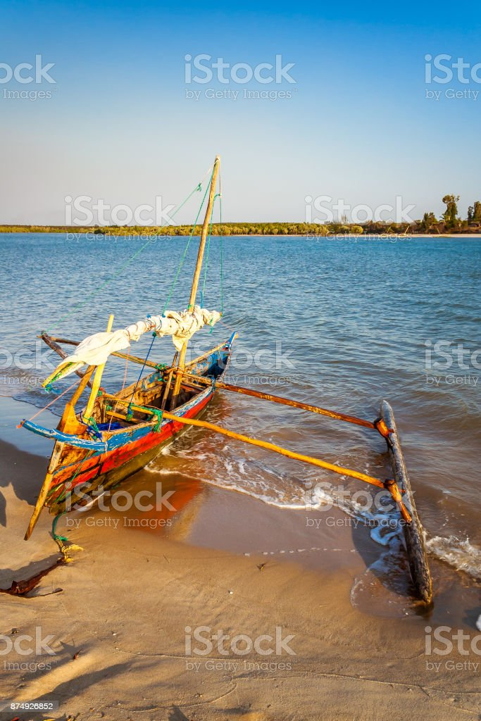 Traditional outrigger canoe stock photo