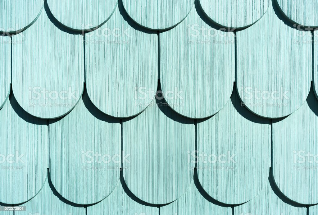 Traditional painted wooden slatted wall stock photo