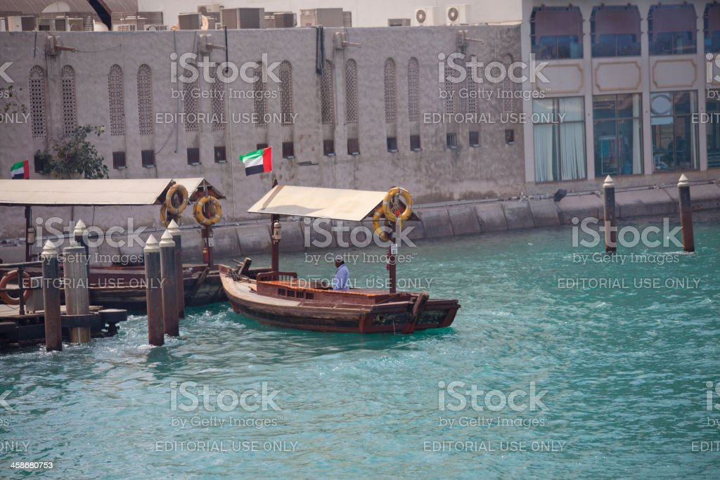 Traditional passenger boat at Dubai creek of UAE stock photo