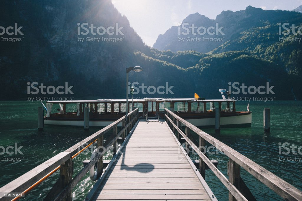 Traditional passenger boat on Konigssee lake at sunset, Bavaria, Germany stock photo