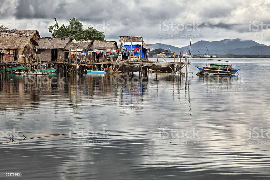 Traditional Philippine village on the water royalty-free stock photo