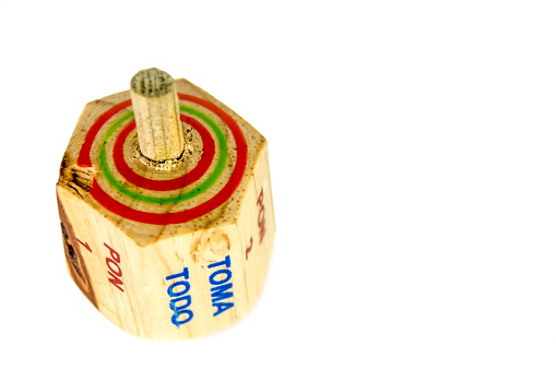 """Traditional pirinola mexican handcrafted wooden toy with titles in spanish """"take all, put one, put two, everyone puts"""""""
