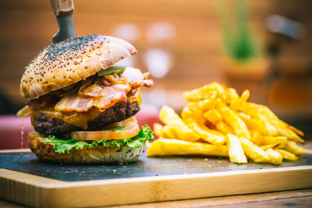 Traditional plate of chips and burger sandwich stock photo