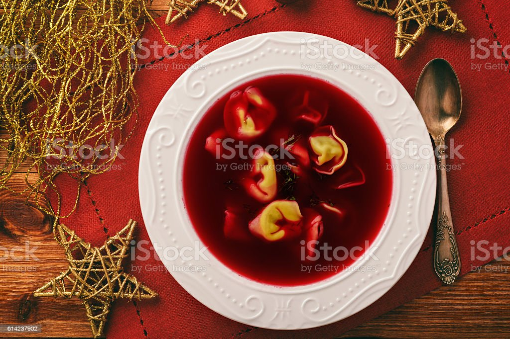 Traditional Polish christmas soup -  red borscht soup with dumplings. stock photo