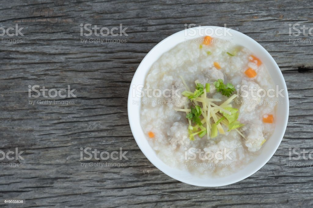 Traditional porridge rice with pork  in white bowl stock photo