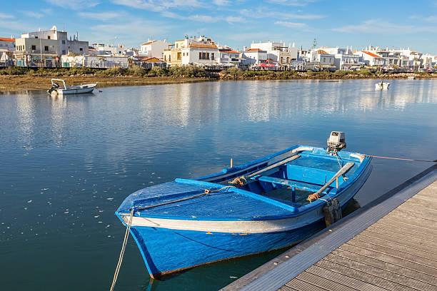 Traditional Portuguese boat at the dock. View Cabanas de Tavira. stock photo