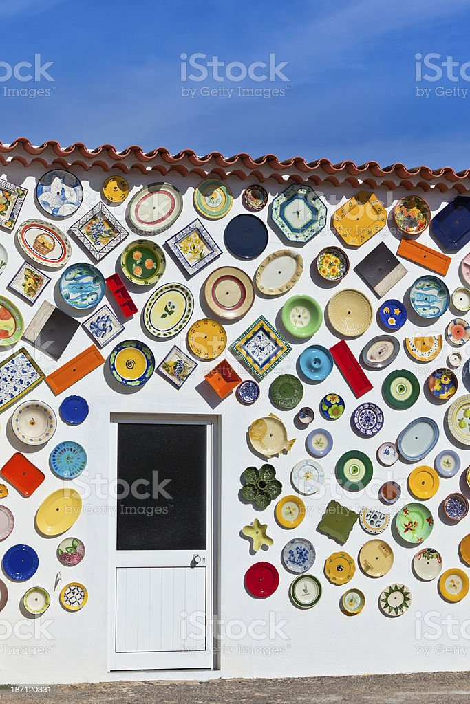 Traditional portuguese pottery plates on a wall in Algarve stock photo