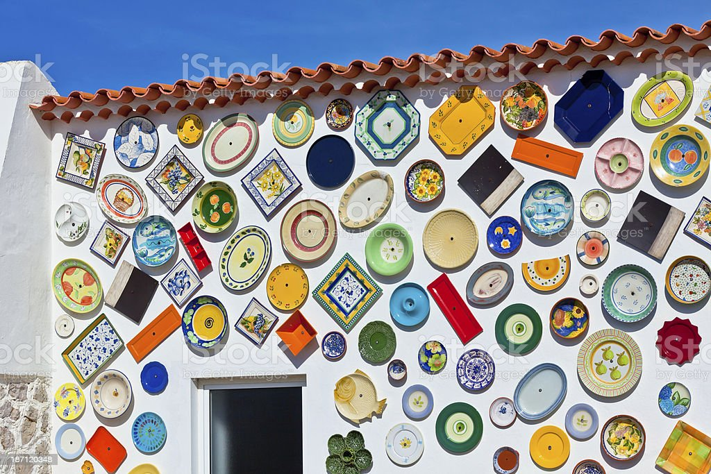 Traditional portuguese pottery plates on a wall royalty-free stock photo