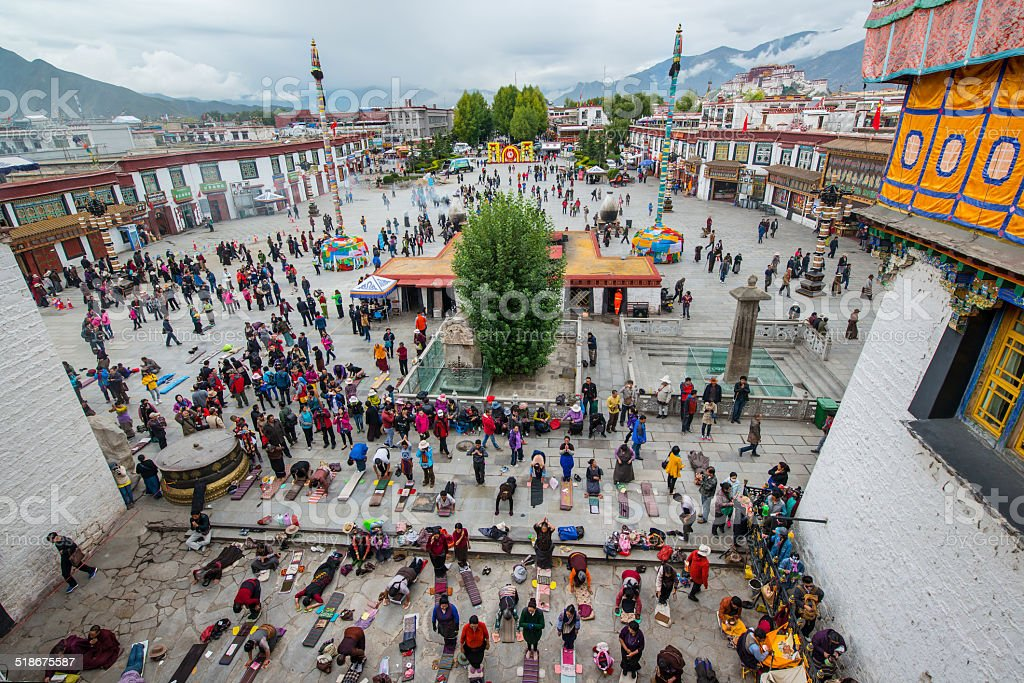Traditional prayers and prostrations in front of Jokhang, Lhasa, Tibet stock photo