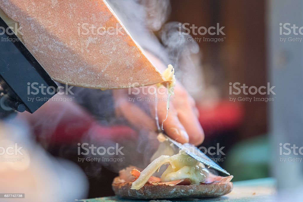 Traditional raclette swiss and french cheese stock photo
