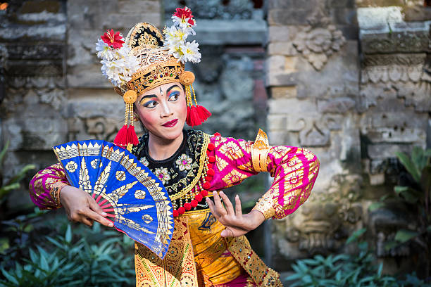 traditional ramayana dancer in a temple of bali - indonesia stock photos and pictures